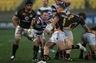 Wellington's TJ Perenara kicks against Auckland. Photo / Getty Images