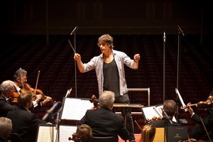 Jeremy Wells tries his hand at conducting. Photo / Supplied