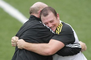 Tony Woodcock wrestles with scrum coach Mike Cron during training. Photo / Mark Mitchell