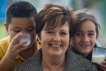 Glenavon School principal Elaine Herbert, who remembers getting school milk as a child, with 7-year-old students Darren Iese and Kairangi Takai-Latu. Photo / Richard Robinson.