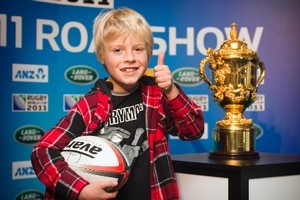 Cody Coughlan, 8, who plays for East Coast Bays, got a good look at the trophy. Photo / Natalie Slade