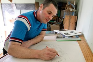 Justin Newcombe draws up garden design plans on his drawing board. Photo / Steven McNicholl