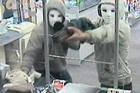 The masked men were caught on PaperPlus' security cameras as they terrified staff with their weapons. Photo / Supplied