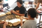 Children at Porangahau School work together to prepare food for classmates. Photo / Supplied