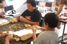 Children at Porangahau School work together to prepare food for classmates. Photo / Supplied