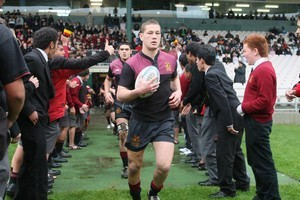 Tawera Kerr-Barlow leads out the Hamilton BHS 1st XV in the national final against De La Salle in 2008. Photo / Supplied