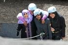 Anjum Rahman (L), Radiya Ali, Khatra Omar and Aaminah Ghani abseiling at Pirongia Forest park Lodge. Photo / Stephen Barker