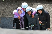 Anjum Rahman (L), Radiya Ali, Khatra Omar and Aaminah Ghani abseiling at Pirongia Forest park Lodge. Photo / Stephen Barker