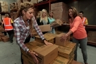 Sally Ridge (left), Paula Herbert, Jo Holley and Miriama Smith help pack food for KidsCan. Photo / Brett Phibbs