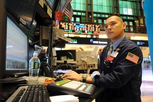Mark Otto of Knight Capital Americas, works on the floor of the New York Stock Exchange Tuesday, July 26, 2011, in New York. Photo / AP