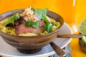 Hokkien noodles with beef, coconut laksa sauce and coriander. Photo / Babiche Martens