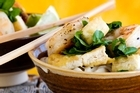 Udon noodles, prawns, fried tofu and watercress. Photo / Babiche Martens