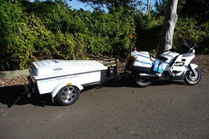 The roadside assistance unit consists of a Honda petrol generator and a modified charging unit in a trailer behind a motorcycle. Photo / Supplied