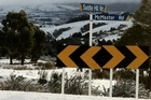 Snow covers the roads at Saddle Hill in Otago. Photo / Graham Copson