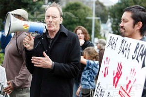 Protesters outside the venue where former British Prime Minister Tony Blair speaks to an audience during his speaking tour, Eden Park, Auckland. Photo / NZPA
