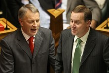 Voters may like Phil Goff's policies, but John Key (right) trounces in the preferred Prime Minister stakes. Photos / File