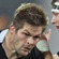 Richie McCaw of the All Blacks fends off CJ Van Der Linde of the Springboks. Photo / Getty Images