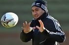 A wrapped up Mils Muliaina trains with the All Blacks. Photo / Getty Images