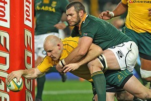 Danie Roussow of the Springboks can't stop Stephen Moore of Australia from coring a try. Photo / Getty Images