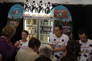 The team at the Piako Gourmet Yoghurt stand hand out samples on the opening day of this year's Auckland Food Show. Photo / Michael Harvey