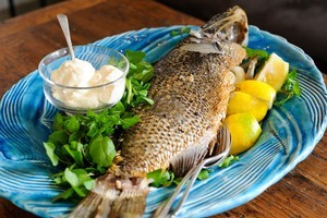 Serve fish fresh and whole, with a sauce and salad. Photo / Jason Dorday