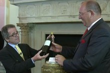 Christian Vanneque, is handed the bottle of 1811 Chateau d'Yquem, which he says he plans to open in five years' time. Photo / AFP