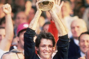 David Kirk lifts the 1987 World Cup. Photo / Getty Images
