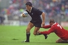 Zinzan Brooke evades a tackle during the 1991 World Cup quarter-final against Canada in Lille, France. Photo / Allsport