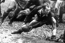Sid Going gets the ball in atrocious conditions at Wellington's Athletic Park in the 1969 North Island vs South Island match. Photo / NZ Herald Archive 