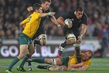 Jerome Kaino steps through the tackle of Rocky Elsom. Photo / Getty Images 