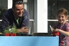 Justin Newcombe with his daughter Greta and the finished plant station. Photo / Greg Bowker