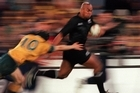 Jonah Lomu evades the tackle of Stephen Larkham during the match between Australia v New Zealand for the Bledisloe Cup.