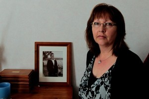 Jayne Carkeek, mother of sailor Byron Solomon, who drowned on HMNZS Canterbury, with her photos of her son. Photo / Brett Phibbs