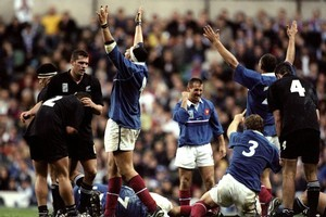 The French celebrate beating New Zealand in the semifinal of the World Cup at Twickenham in 1999. Photo / Allsport