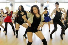 Margaret MacKenzie (centre front) puts her hip-hop students through their steps. Photo / Doug Sherring