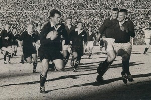 Peter Jones on the charge for the All Blacks against the Springboks in Johannesburg in 1960. Photo / Herald archives