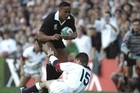 Jonah Lomu bowls over England's Mike Catt to score just two minutes into the 1995 semifinal. Photo / Allsport