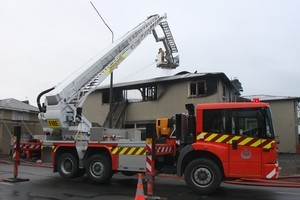 Christchurch firefighters dampen down a recent blaze. Photo / Geoff Sloan