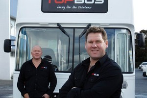 Craig Nicholson (left) and his friend Stephen Hampson-Tindale with Craig's 'Topbus' which he has fitted out for event hire and parties. Photo / Janna Dixon