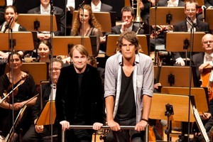 Jeremy Wells with the NZSO and its conductor Pietari Inkinen. Photo / Olivia Taylor