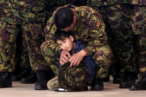 Private Terry Anderson shares his last moments with his son Jaynus. Photo / Getty Images, Photo Researcher / Emma Walter