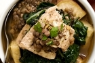 Monkfish with silverbeet, coconut and kumara. Photo / Babiche Martens