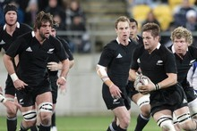 All Blacks captain Richie McCaw leading the charge against the Springboks during last week's test against South Africa. It was the first showing of the new All Blacks jersey. Photo / Mark Mitchell