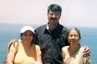 Hiren Mohini, pictured here with his family, was murdered in the Auckland suburb of Mt Eden. Photo / Supplied