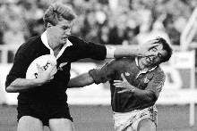 John Kirwan fends off the French defence in the 1987 final.