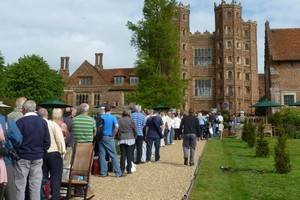 A line of enthusiasts laden with treasures arrive at Layer Marney Tower hoping to hear good news from the experts on Antiques Roadshow. Photo / Jim Eagles