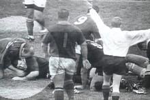 Springbok forward Johan Le Roux bites the ear of All Black captain Sean Fitzpatrick. Photo / TVNZ