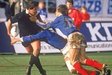 Sean Fitzpatrick is tackled by Serge Blanco and Philippe Sella of France during the 1987 Rugby World Cup Final. Photo / Getty Images