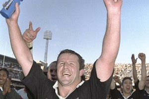 Sean Fitzpatrick celebrates after the 1996 All Blacks won a historic series in South Africa. Photo / Dave Rogers/Allsport