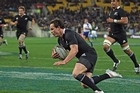 Zac Guildford of the All Blacks dives over to score a try. Photo / Getty Images